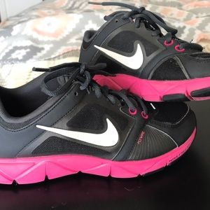 Hot pink and black Nike's running shoe.